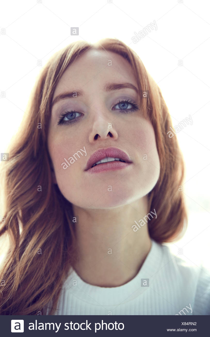 Portrait of lascivious redheaded woman - Stock Image