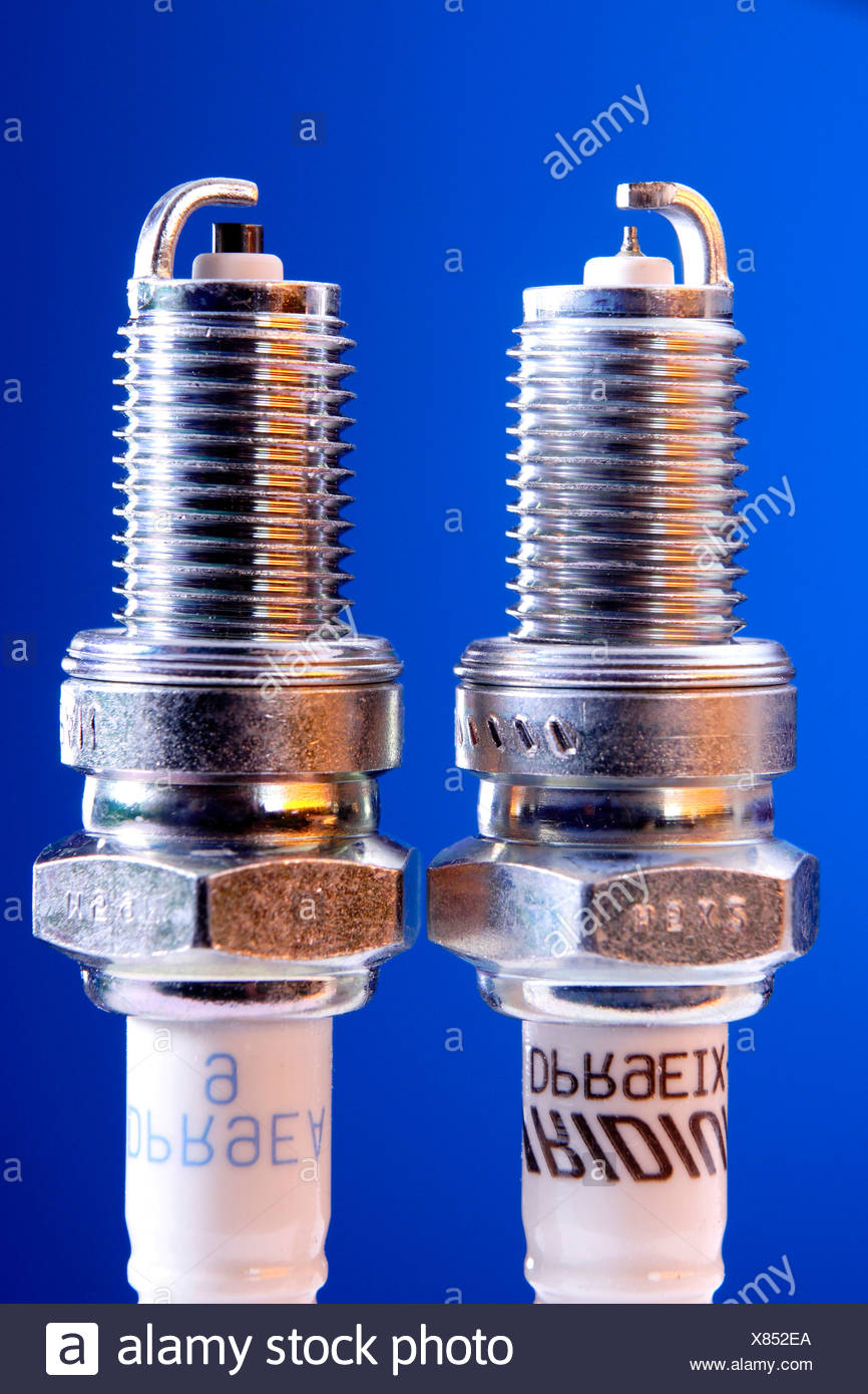 Comparison of iridium spark plug and standard spark plug Stock Photo