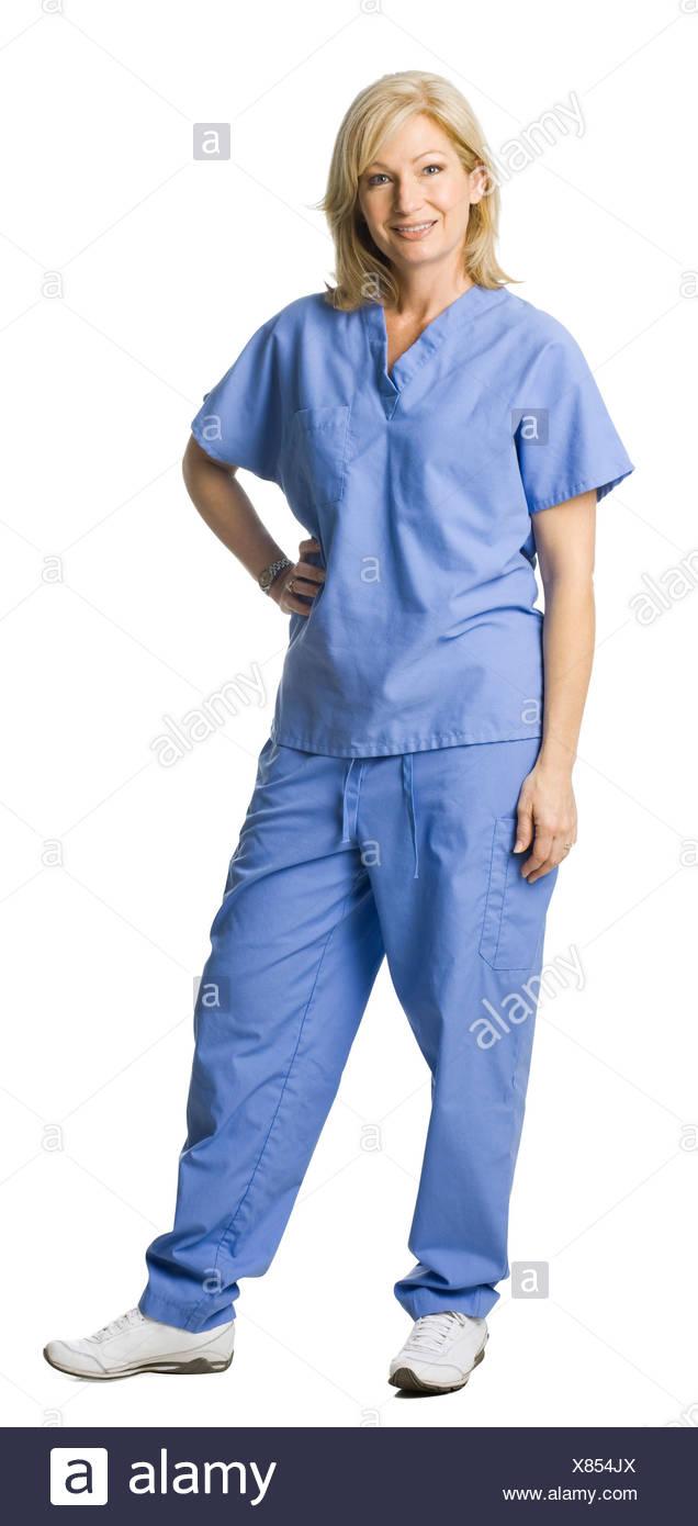 Studio portrait of female nurse - Stock Image