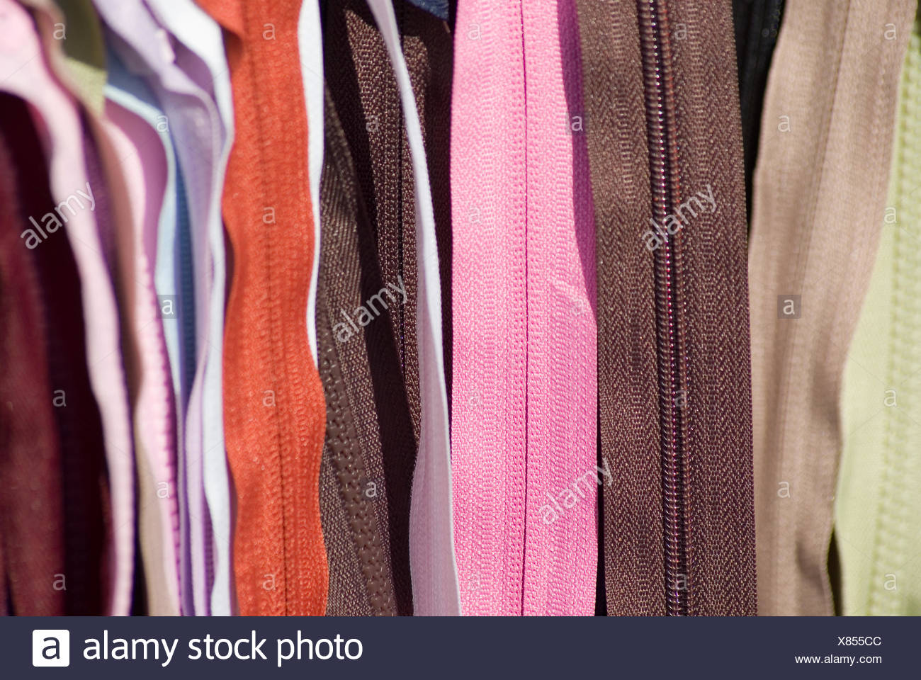 coloured colourful gorgeous multifarious richly coloured metal open sew zipper - Stock Image
