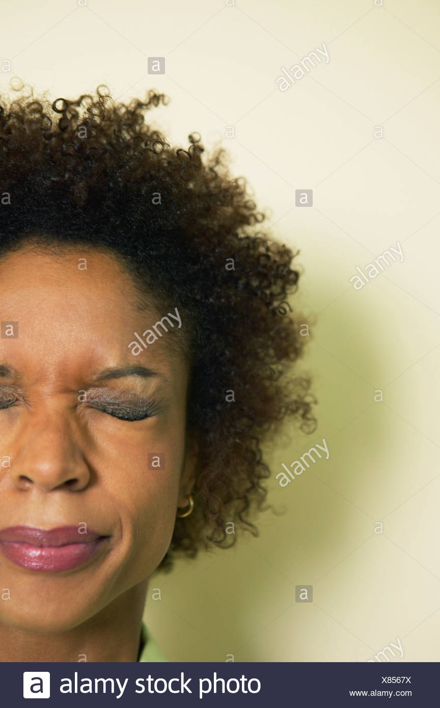 Close-up of a businesswoman grimacing - Stock Image