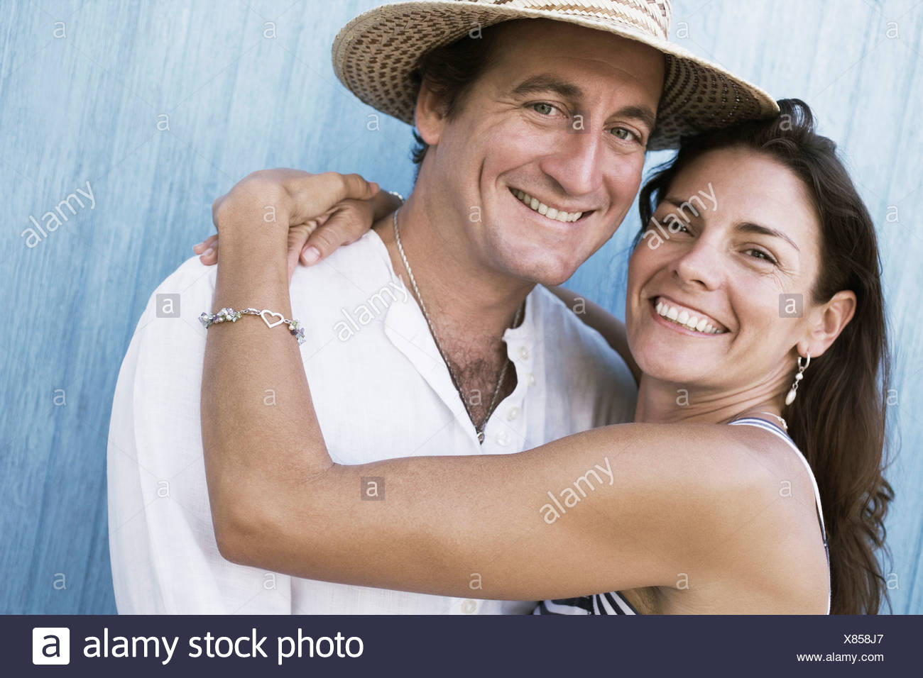 Portrait of a mid adult couple smiling - Stock Image