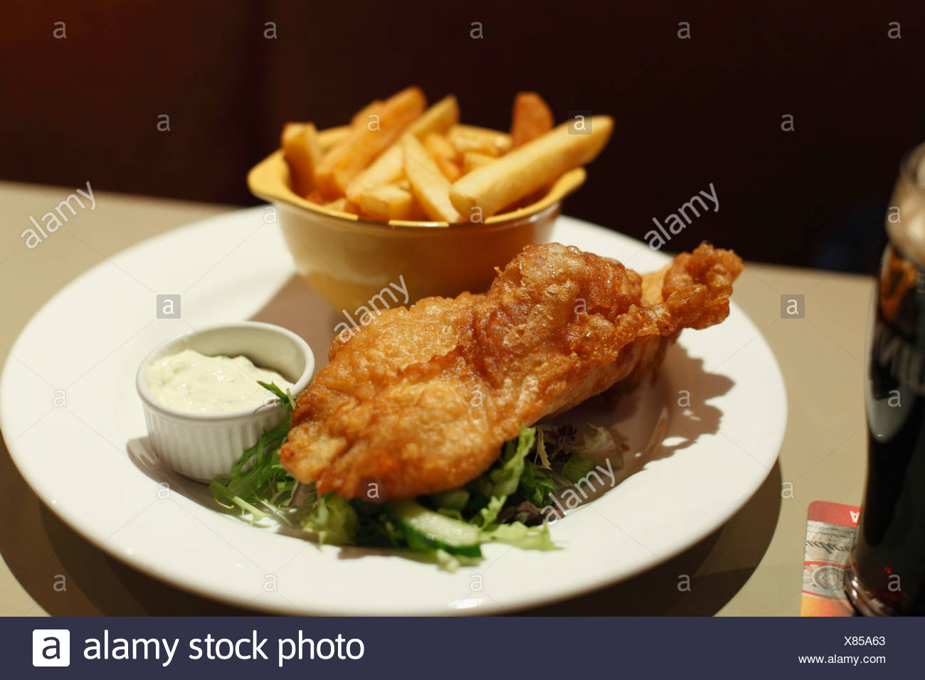 Republic of Ireland, County Fingal, Skerries, Close up of fish and chips in plate Stock Photo