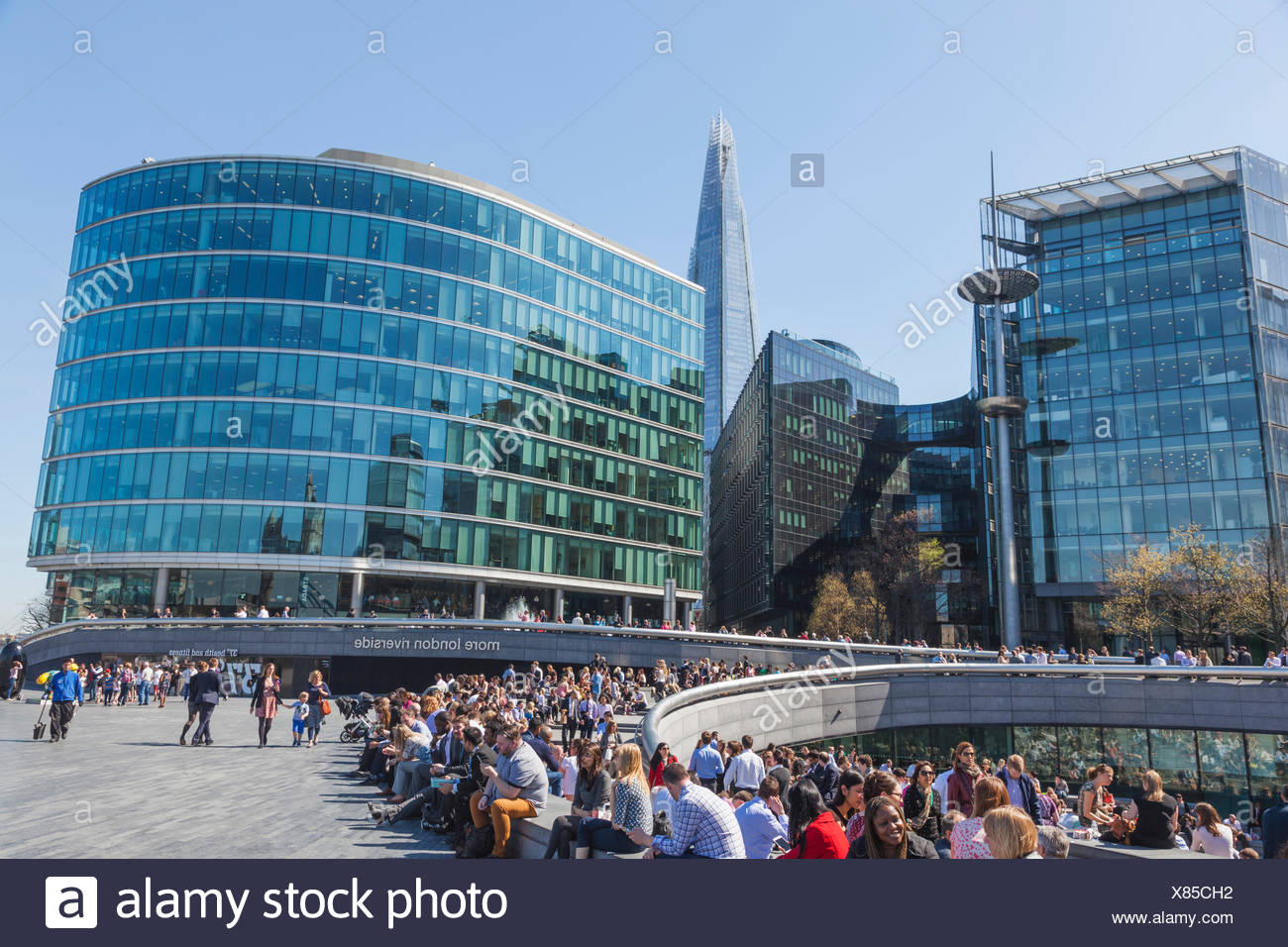 England, London, Southwark, More London Riverside Estate and Lunchtime Office Workers Relaxing - Stock Image