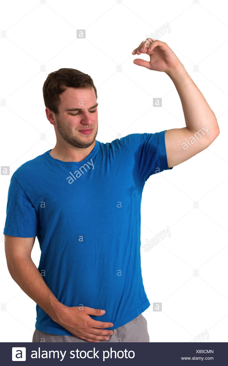 Man sweating very badly under armpit - Stock Image