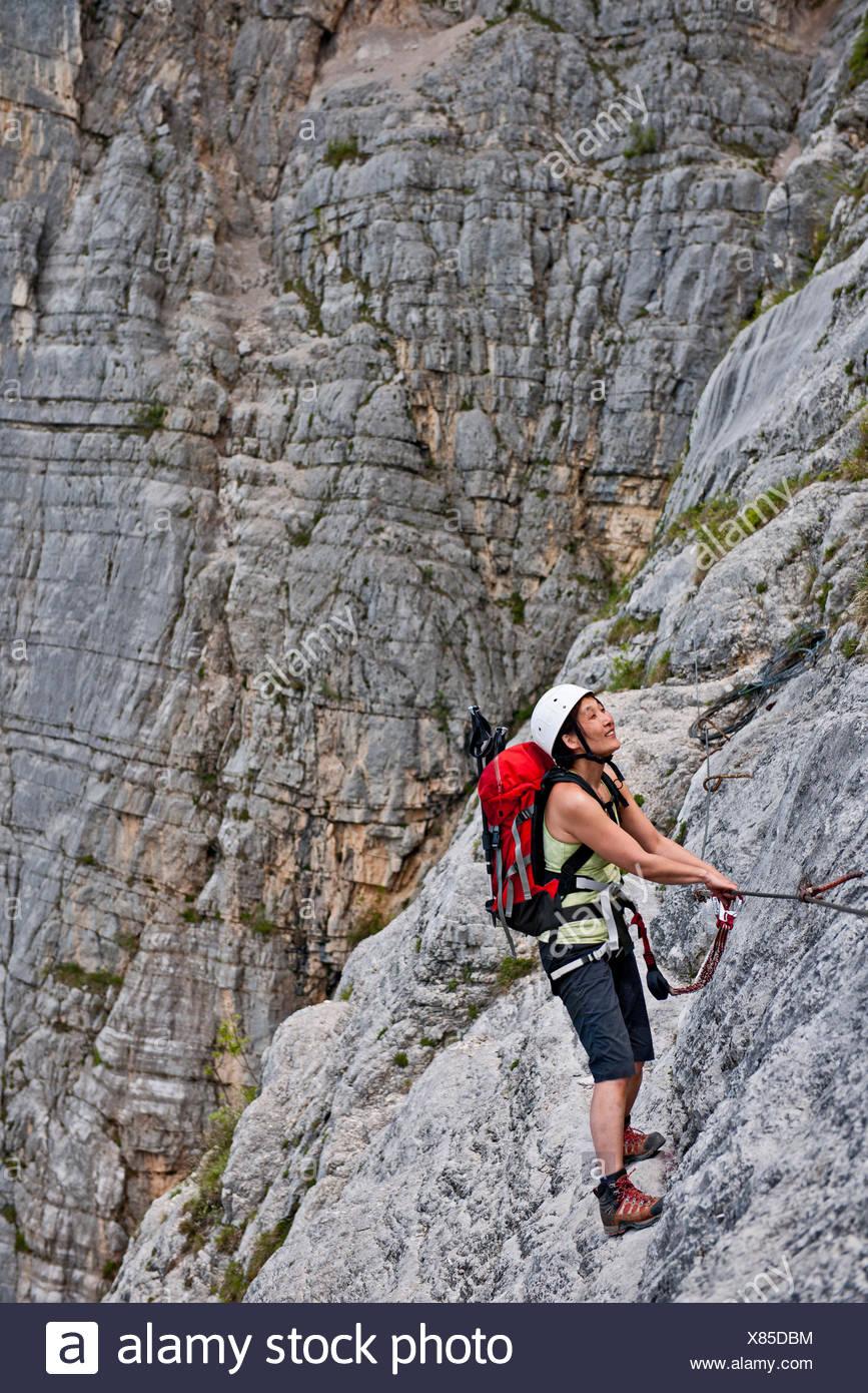 Female climber on via ferrata Che Guevara, Monte Casale, Trentino, Italy - Stock Image