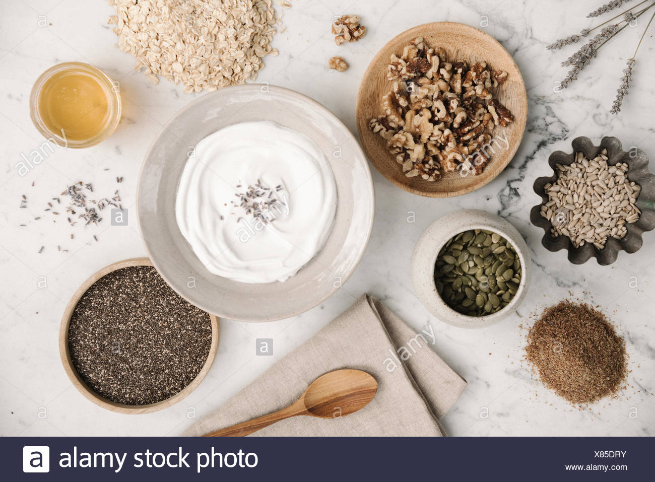 Overhead view of a table with food in dishes. - Stock Image