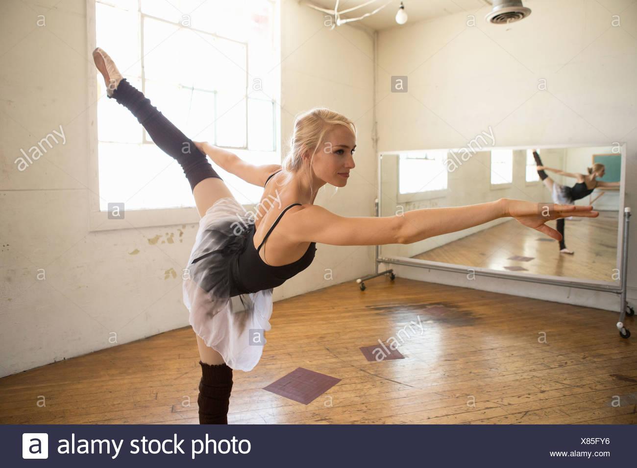 Ballet dancer on one leg in studio - Stock Image