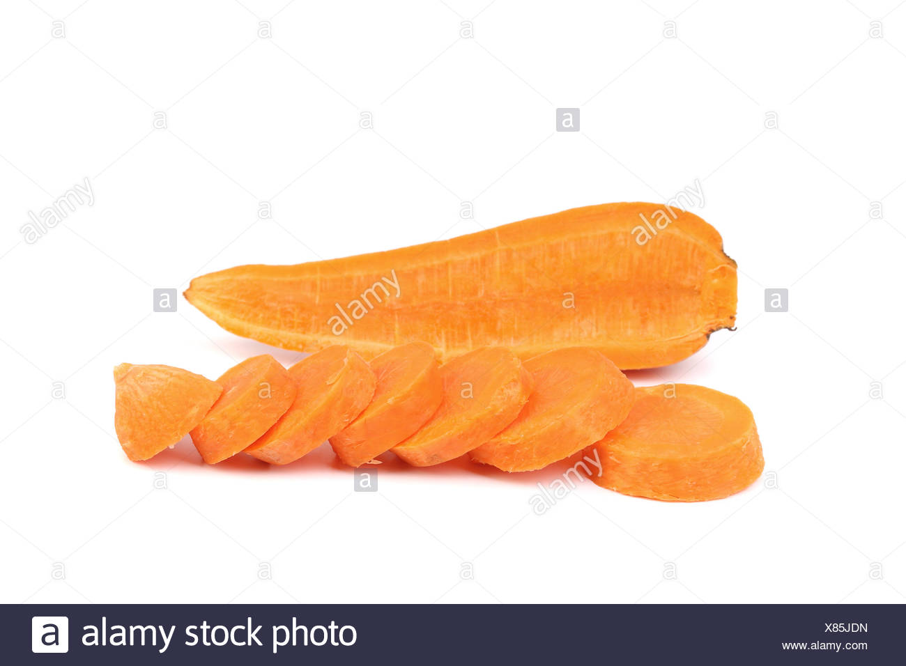 Cross section and slices of Fresh Carrot. - Stock Image
