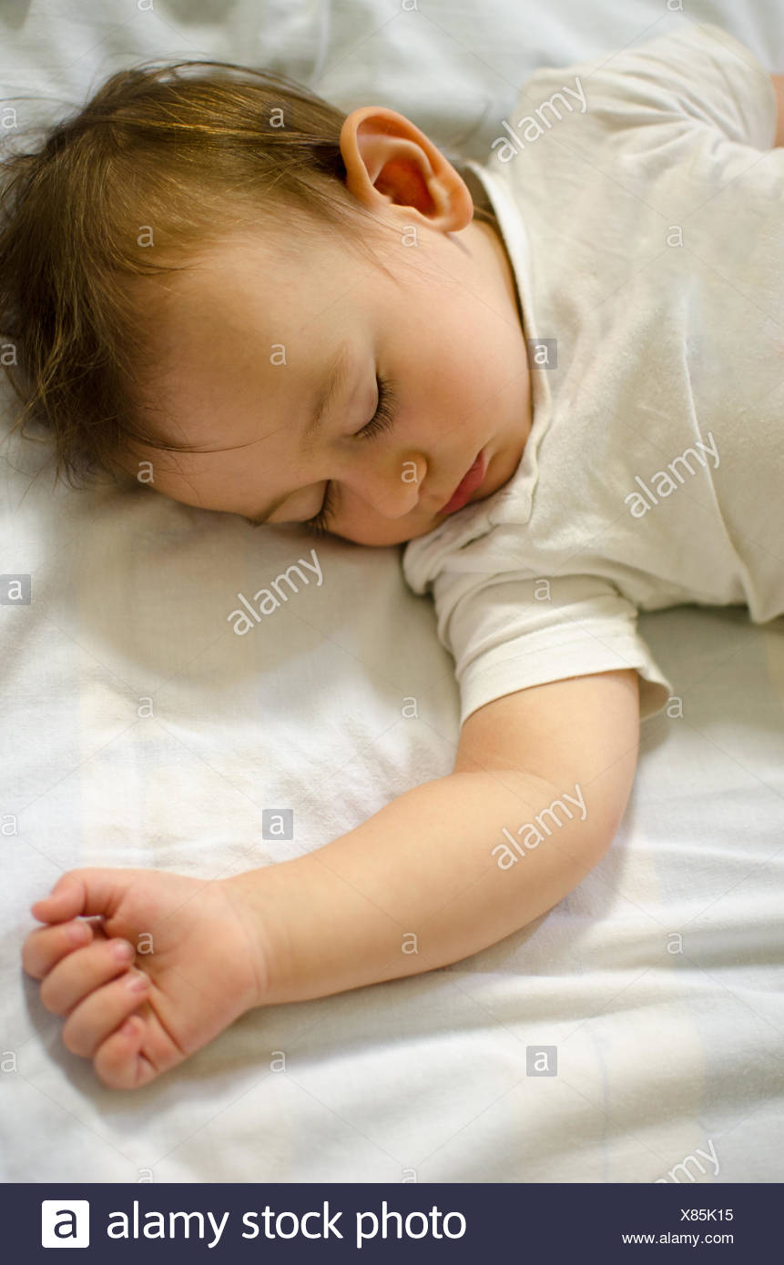 Portrait of sleeping baby (12-17 months) - Stock Image