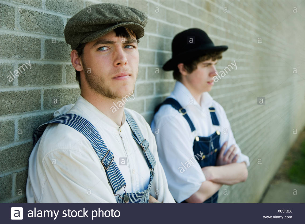 Two young men in old-fashioned garments - Stock Image