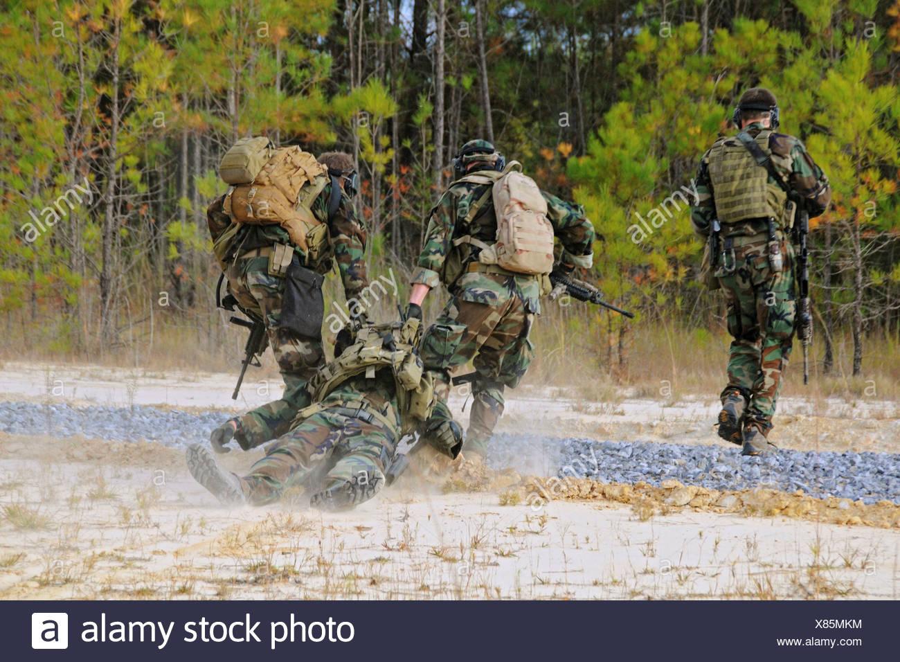 Navy SEALs Simulate Evacuation Injured Teammate - Stock Image