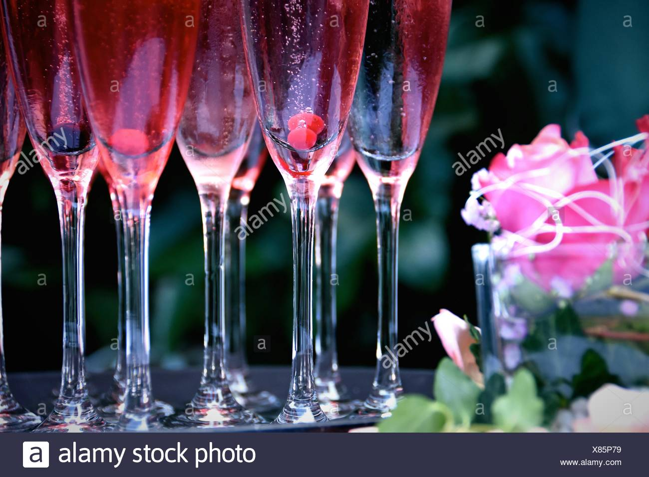 Cocktails In Flutes On Table Stock Photo