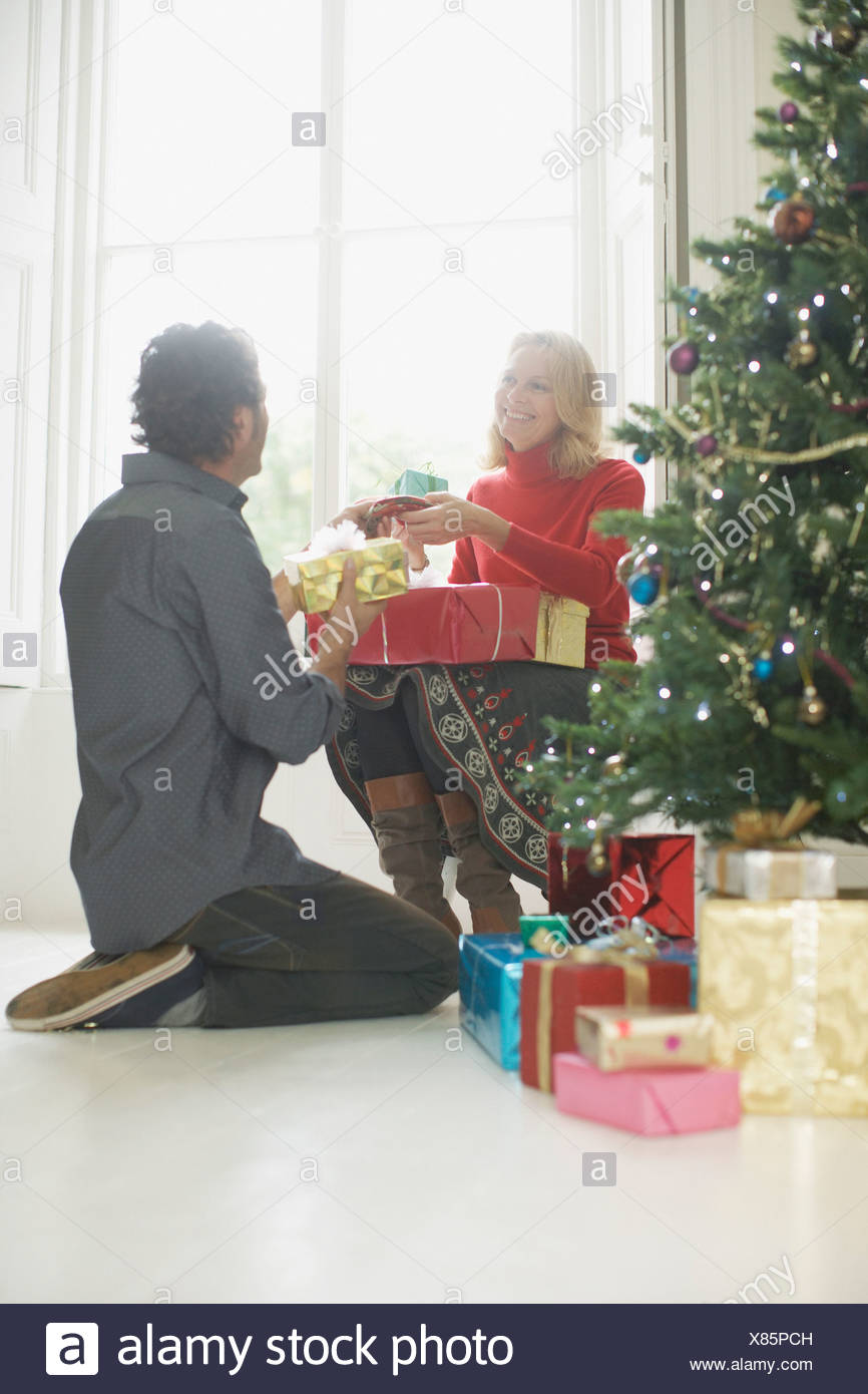 Couple exchanging Christmas gifts Stock Photo