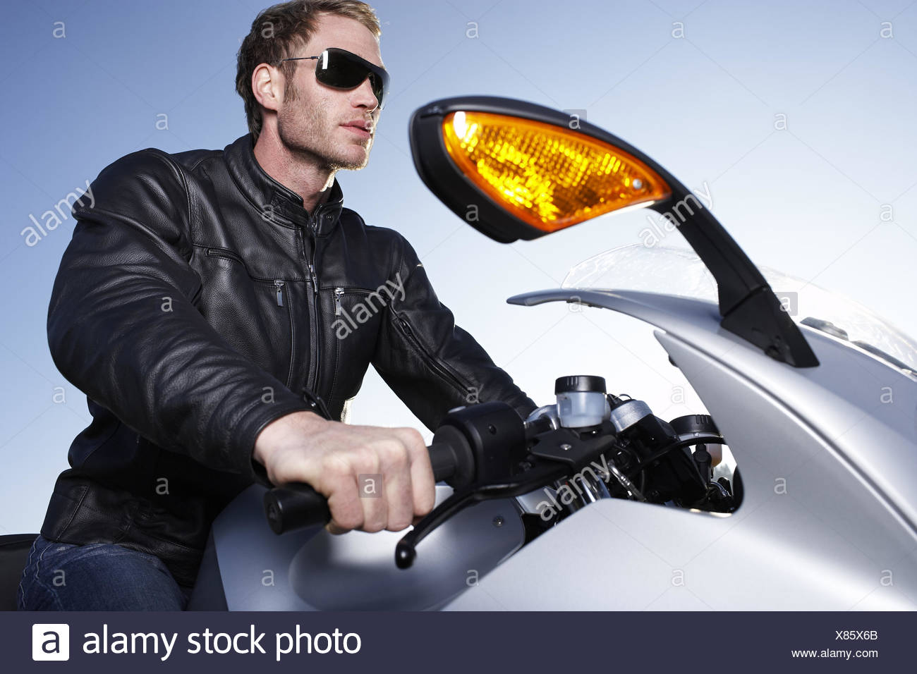Low angle view of man riding motorcycle - Stock Image