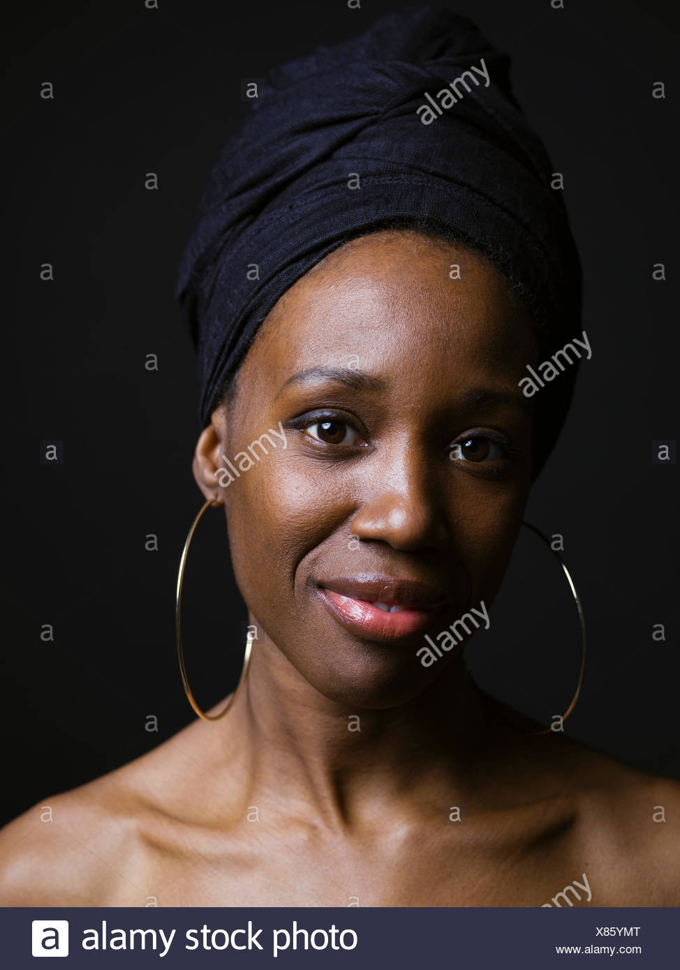 75cb4f741bf76 Portrait confident African American woman wearing headscarf and hoop ...