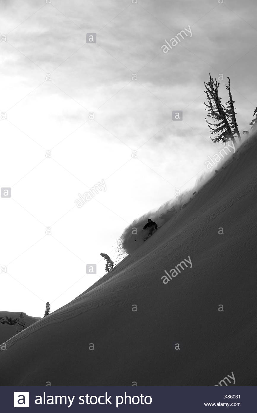 Downhill skiing in the Whistler backcountry, Coast Mountains, British Columbia, Canada. - Stock Image