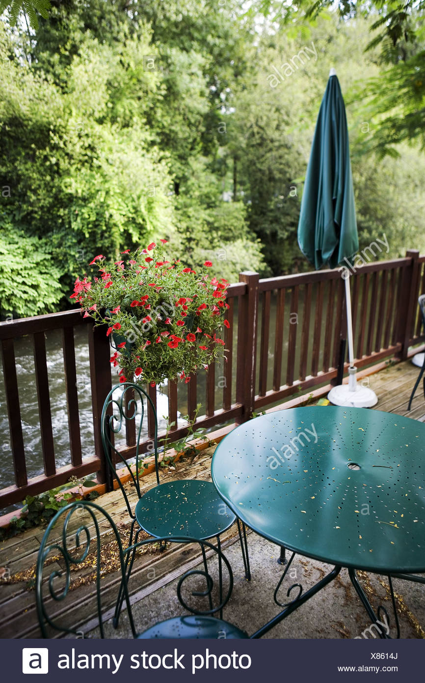 Furniture And A Parasol On A Veranda At A Restaurant In France Stock Photo Alamy