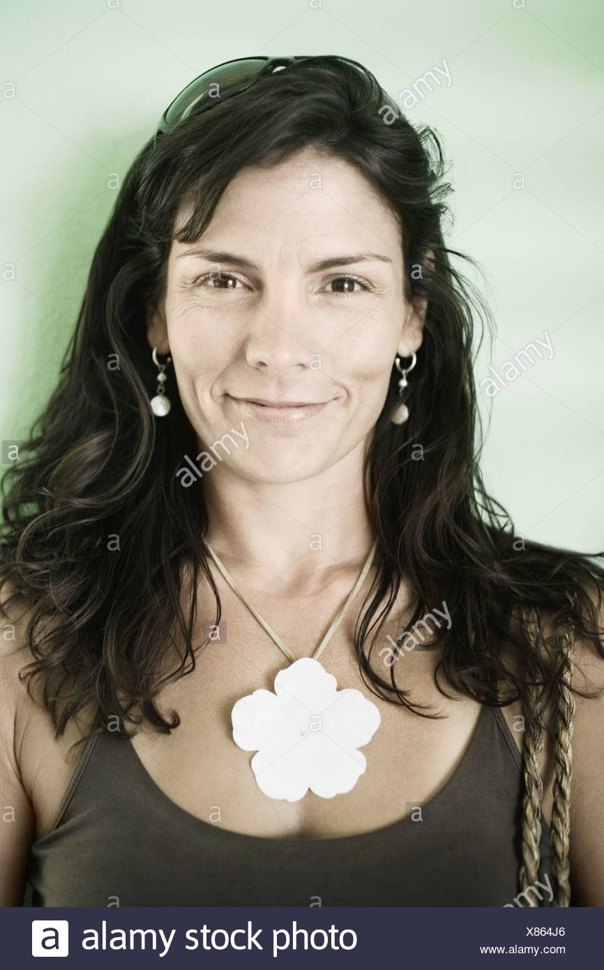 Portrait of a mid adult woman smiling - Stock Image