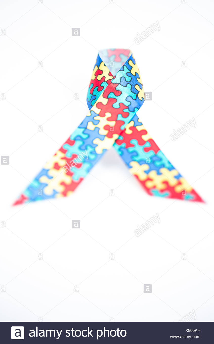 Jigsaw ribbon for autism - Stock Image