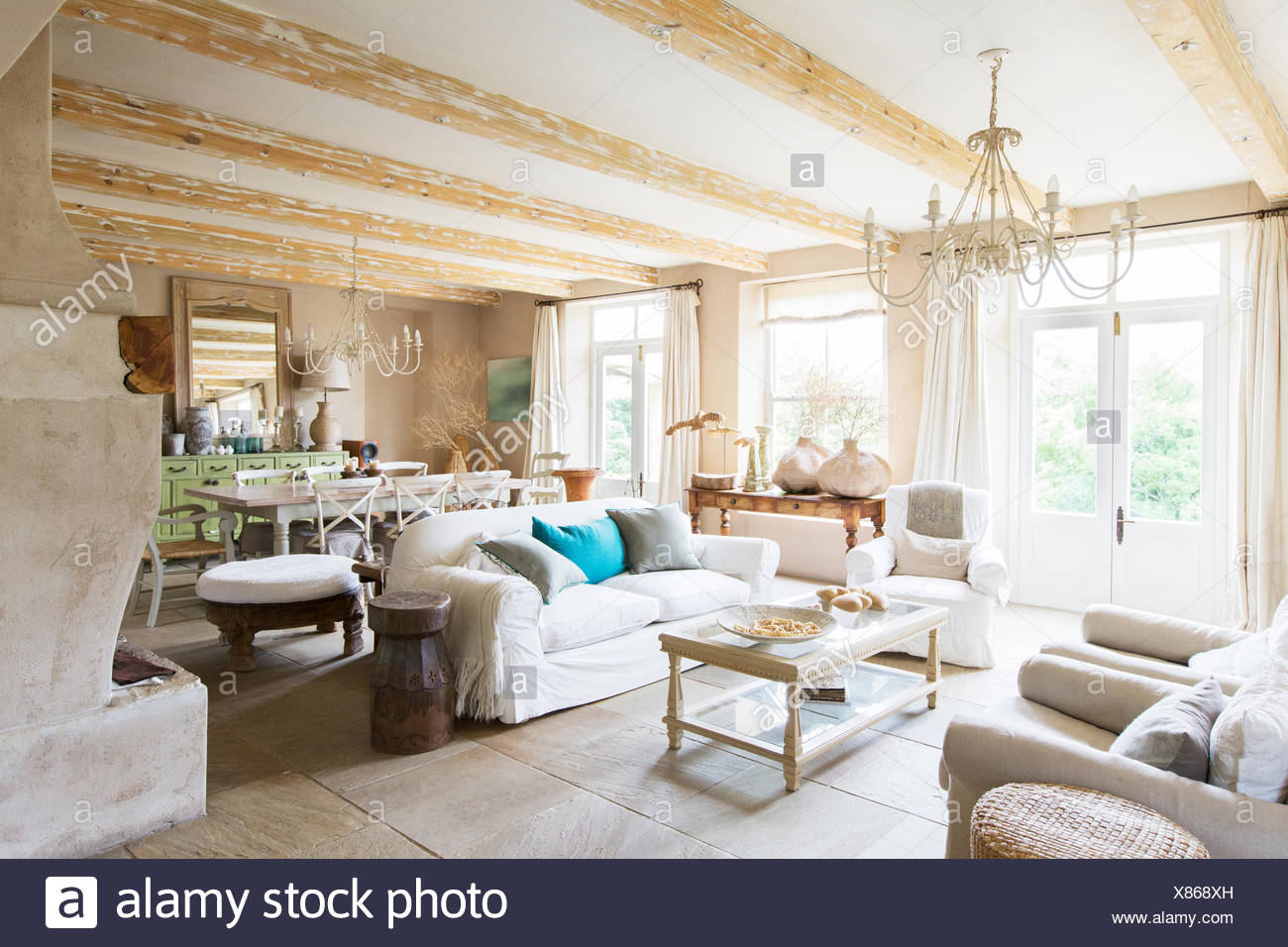 Dining and living area of rustic house - Stock Image
