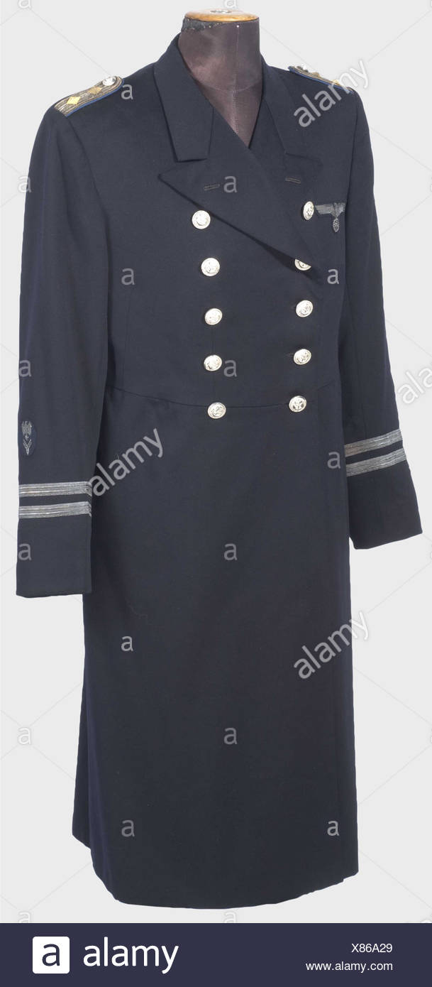 A dress uniform coat for a senior administrative official., Private purchase piece of fine, navy blue cloth with silver anchor buttons, sleeve bars (First Lieutenant), embroidered party eagle, and branch insignia. Sewn shoulder boards for a naval lieutenant with cornflower blue backing. Black silk lining. historic, historical, 1930s, 1930s, 20th century, navy, naval forces, military, militaria, branch of service, branches of service, armed forces, armed service, object, objects, stills, clipping, clippings, cut out, cut-out, cut-outs, Additional-Rights-Clearances-NA - Stock Image