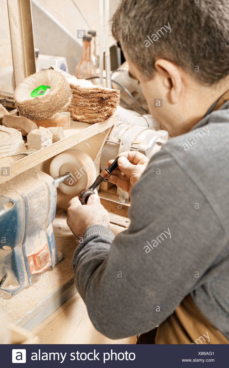 Woodworker working on grinder Stock Photo