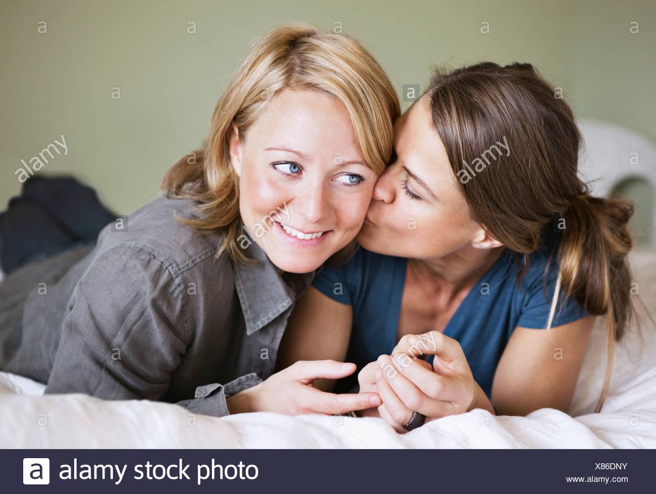 Girlfriends cuddle - Stock Image