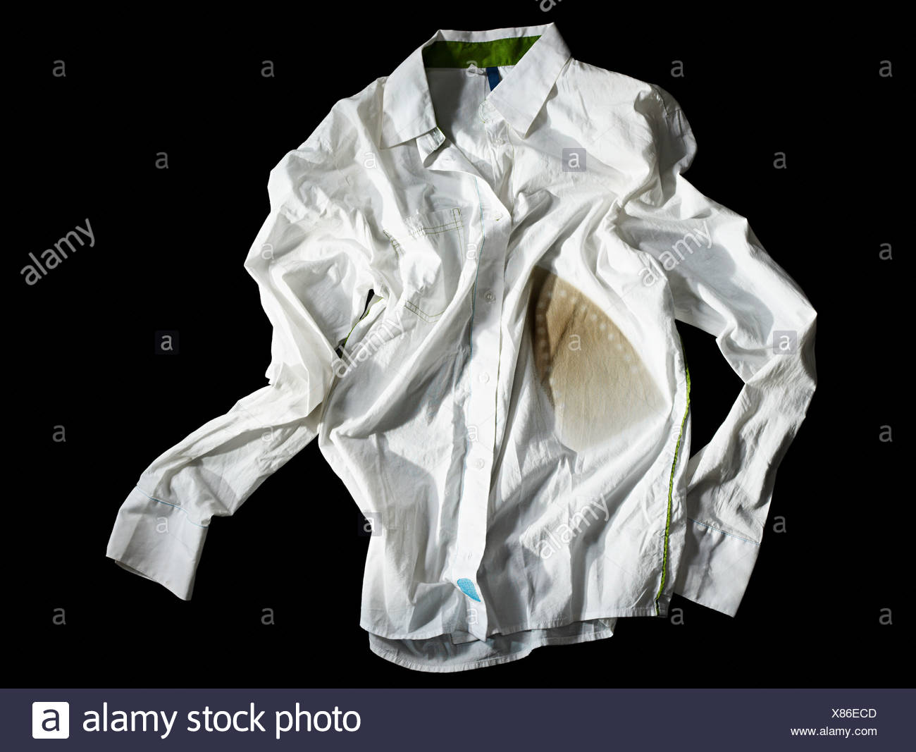A crumpled burned white shirt - Stock Image