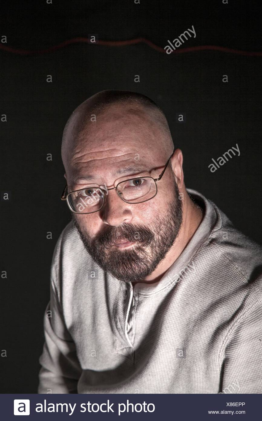 Middle Age Bald Man With A Beard And Glasses.   Stock Image