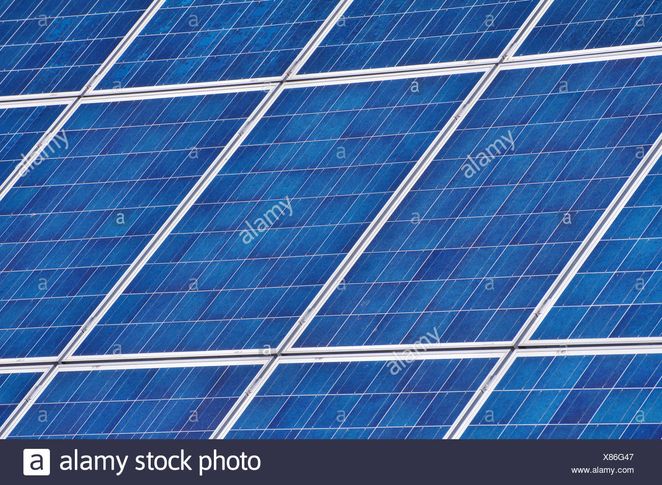 solar panels on a house roof - Stock Image