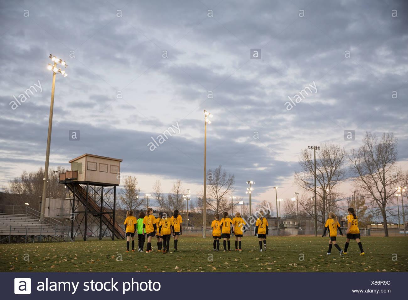 Soccer team walking on field - Stock Image