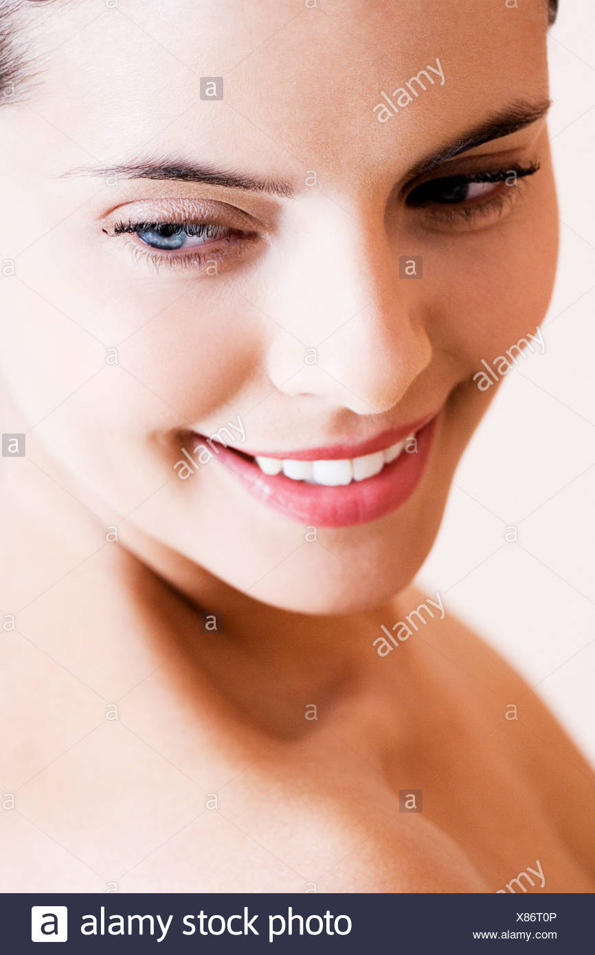 Portrait of young woman, looking downwards - Stock Image