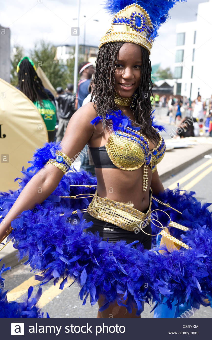 Young woman in carnival costume. Notting Hill Carnival, Notting Hill. London. England. UK. - Stock Image