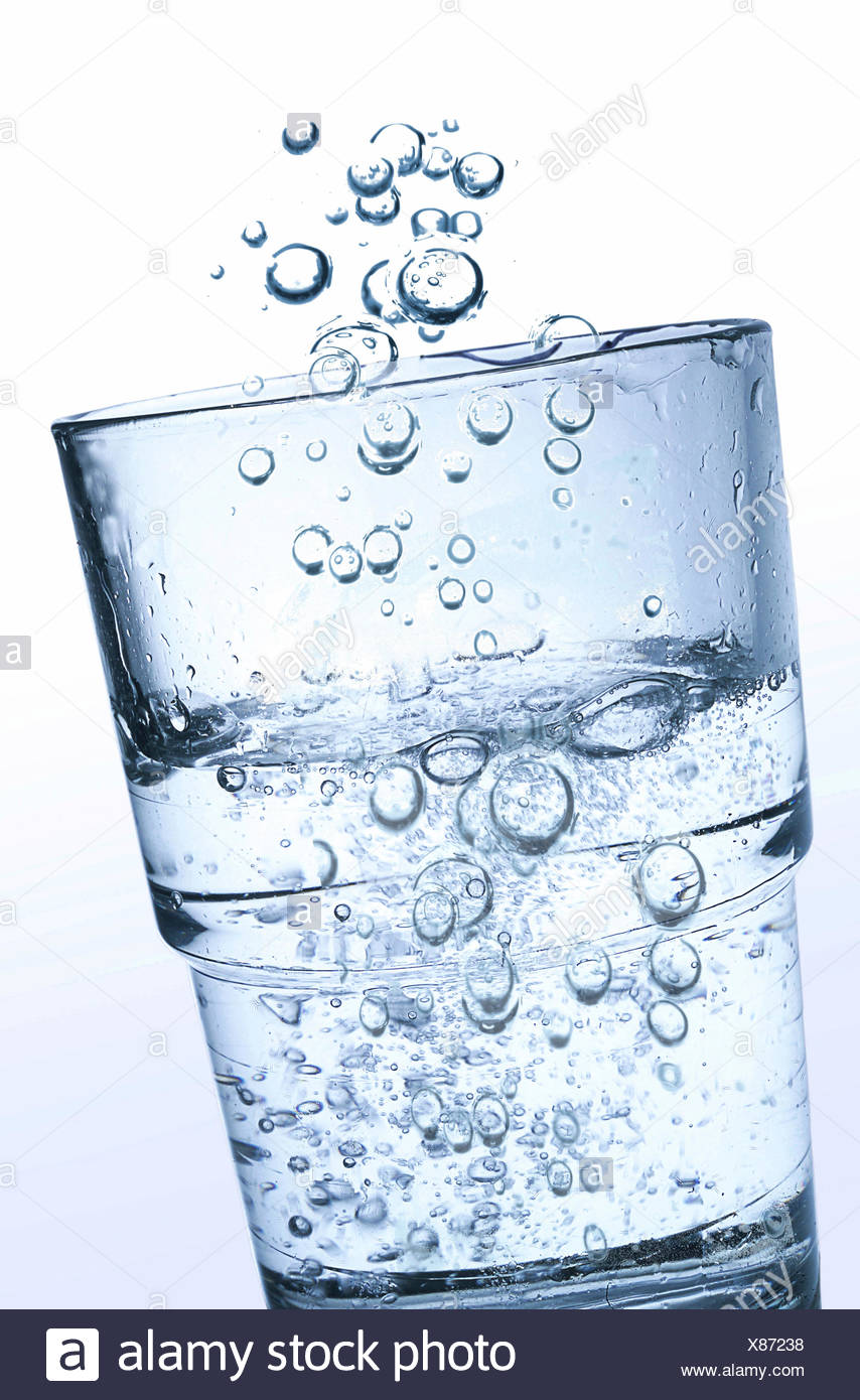 A glass of carbonated water - Stock Image