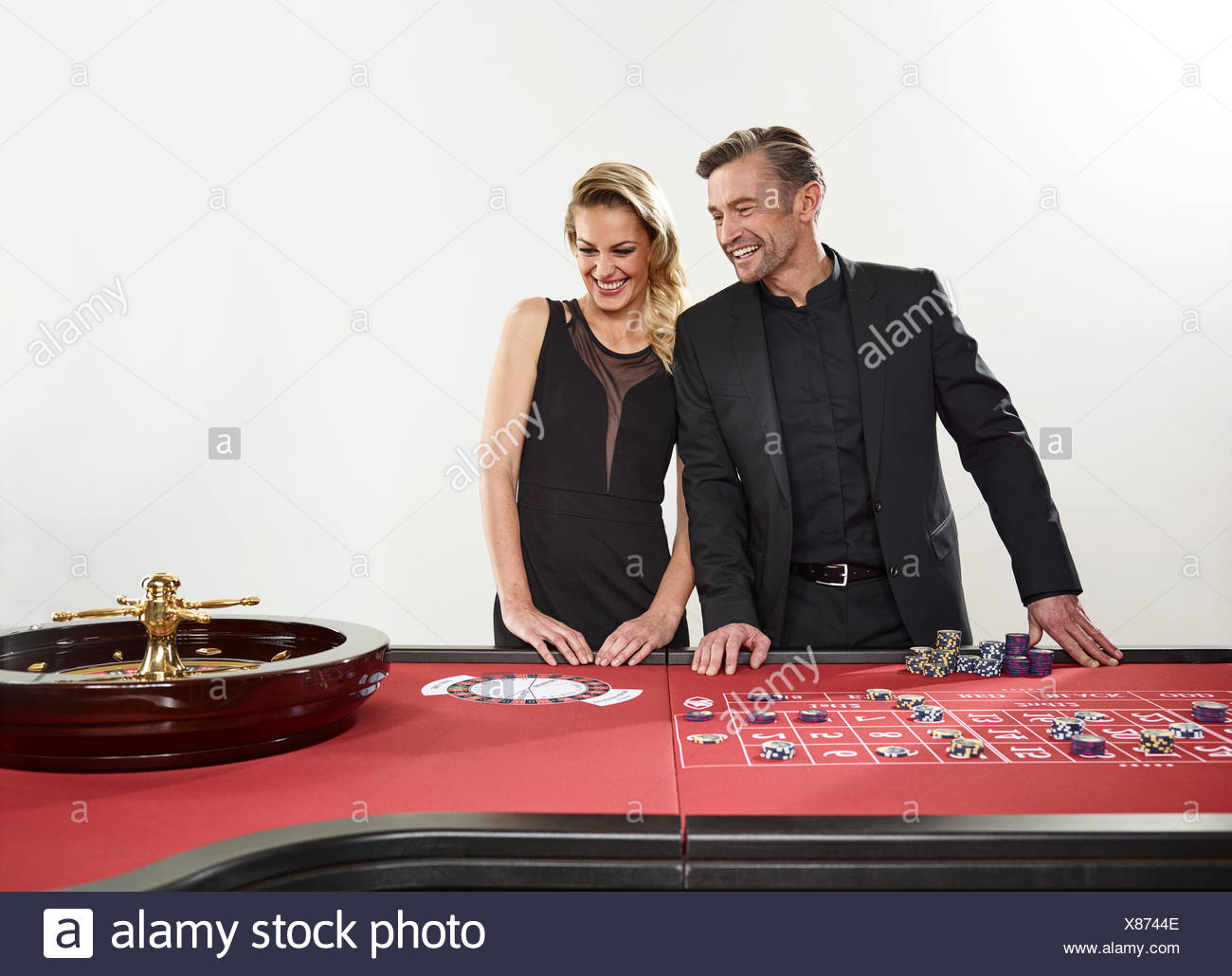 Couple playing roulette, casino, chips - Stock Image