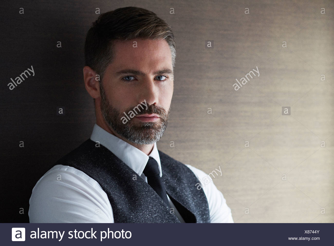 Portrait of businessman looking at camera - Stock Image