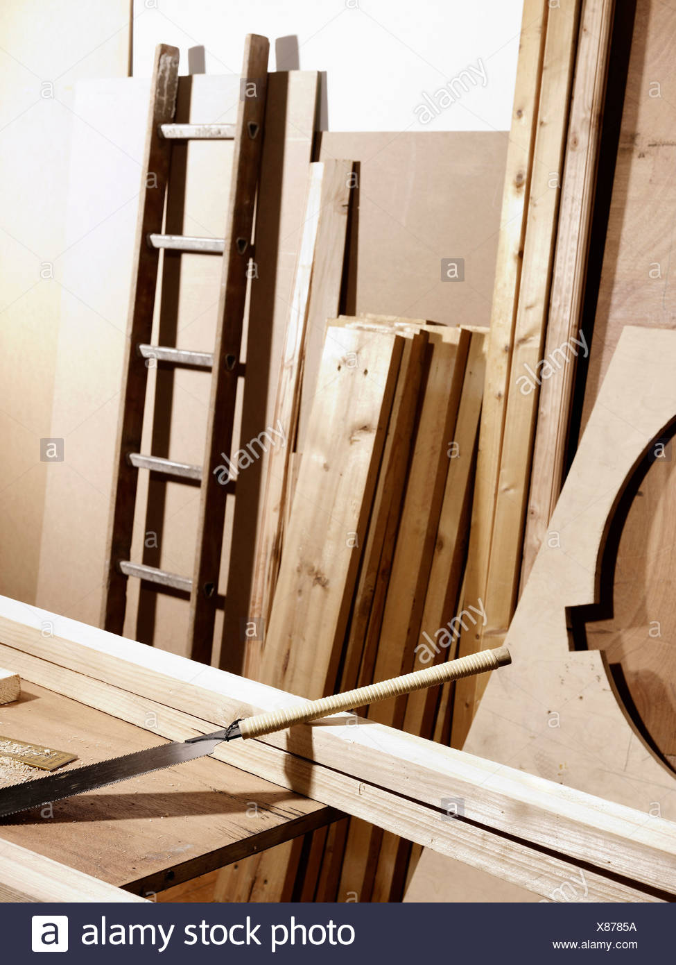 A work bench and planks of wood - Stock Image