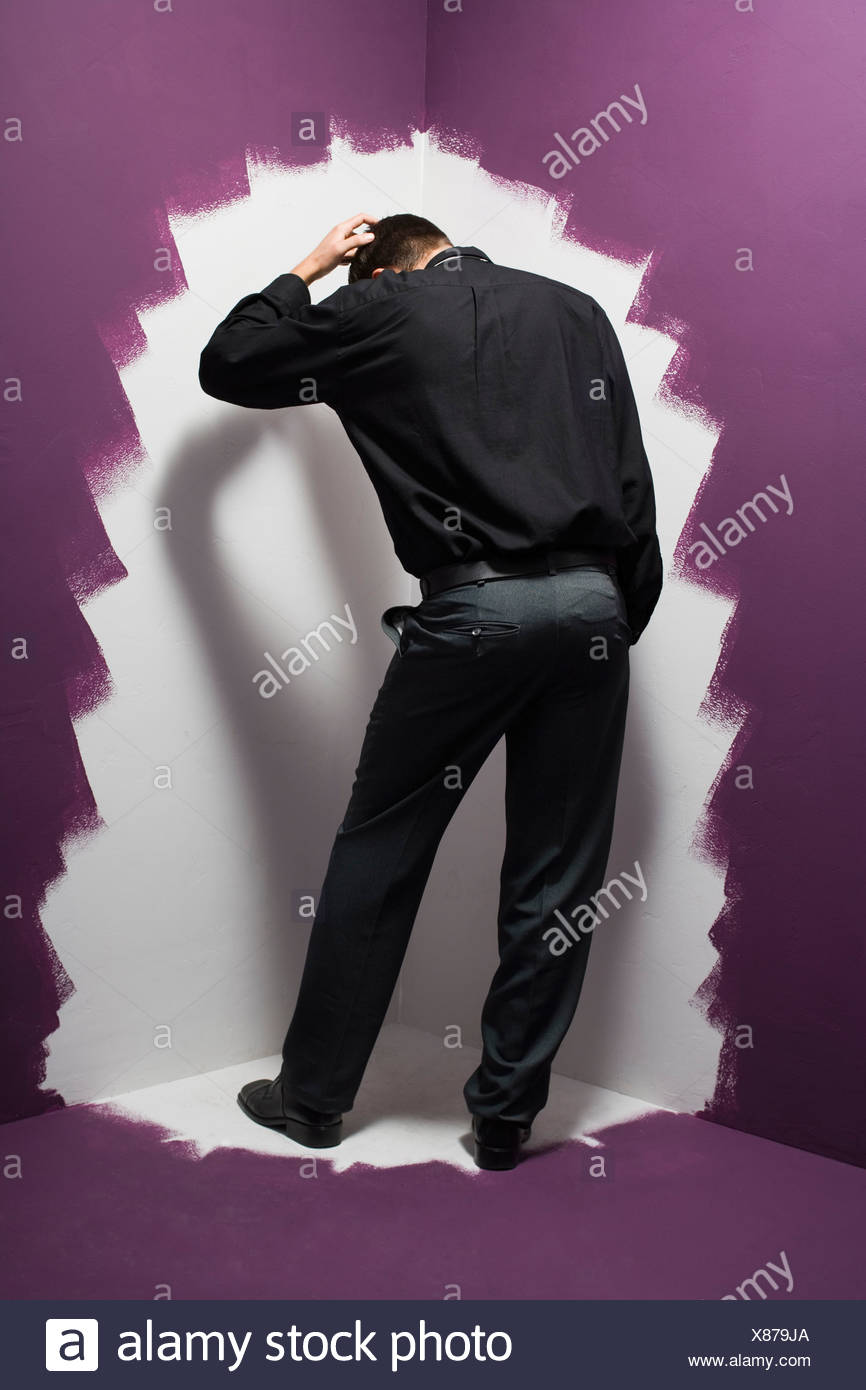 Man standing in the corner - Stock Image