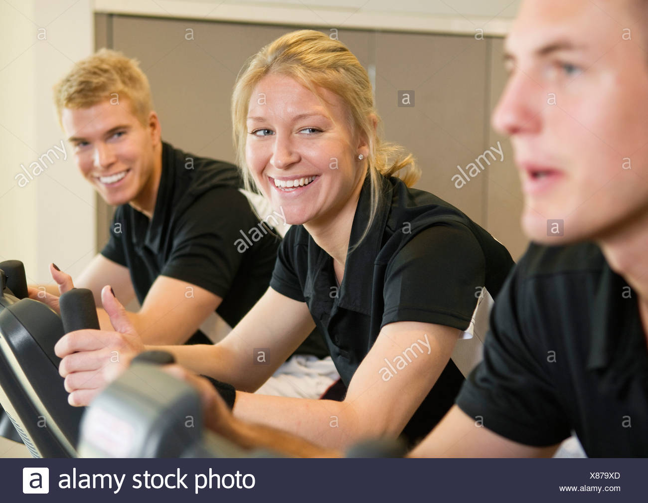 Three friends working out - Stock Image