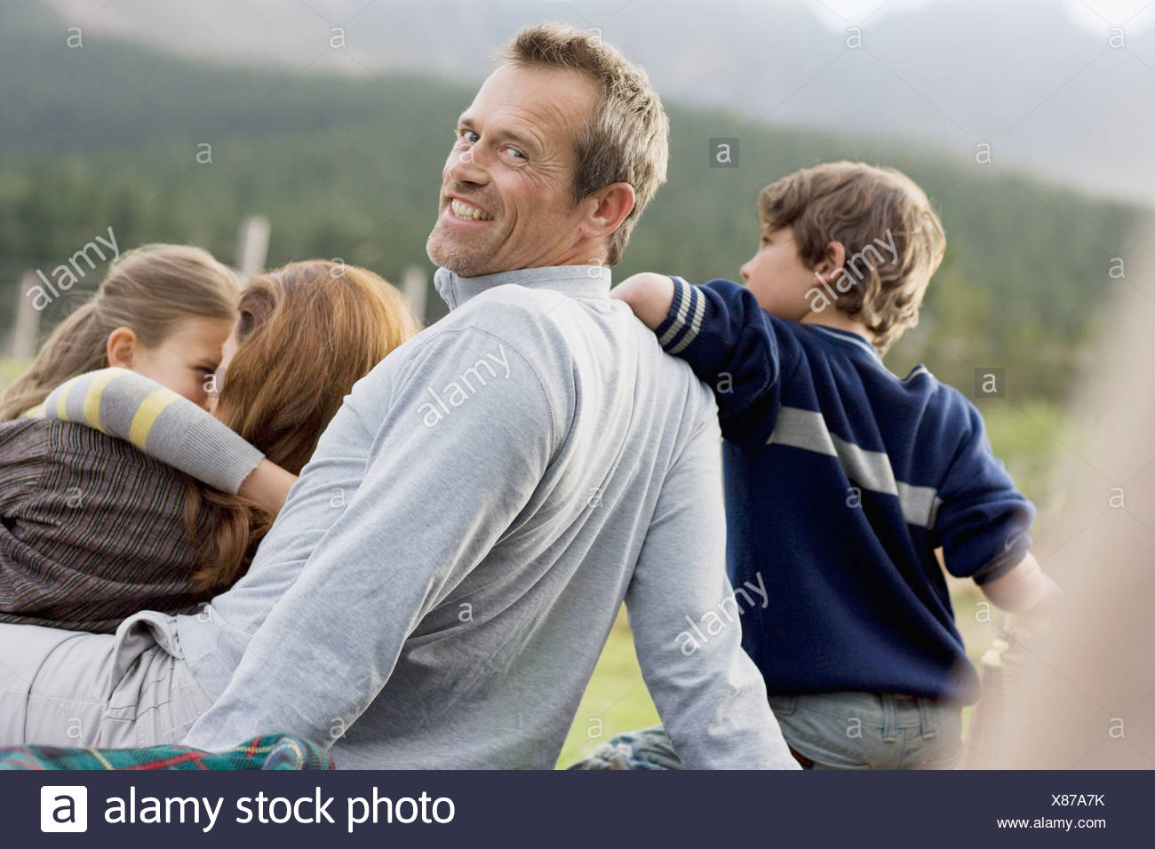 Family hanging out together outdoors - Stock Image