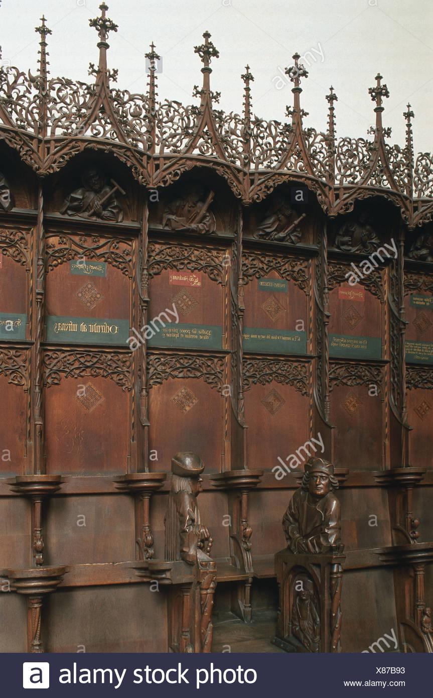 Germany, Bavaria, The Allgäu, Memmingen, Martinskirche, Gothic carvings including lifelike portraits wooden presbytery stalls - Stock Image