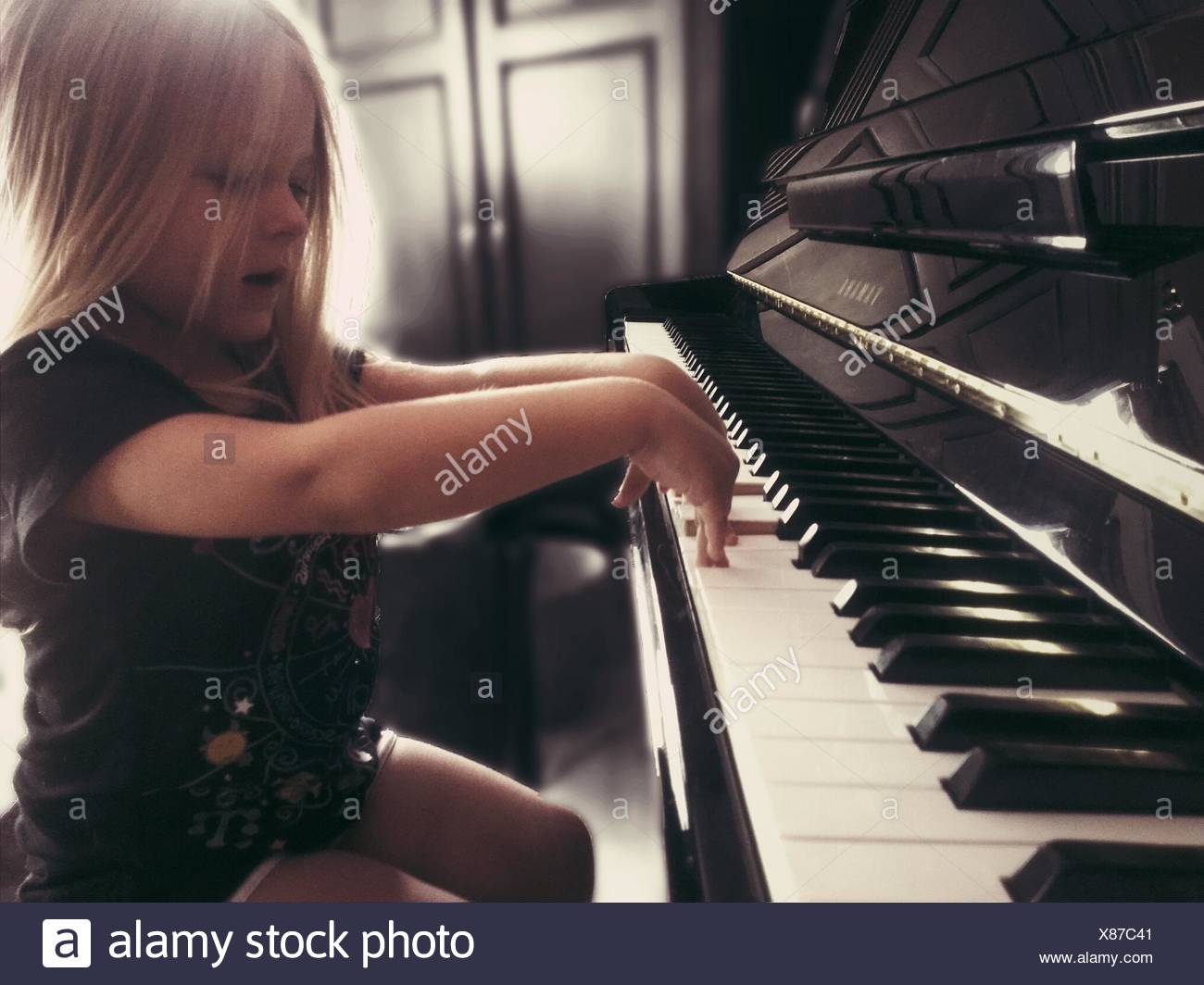 137796c7ad3 Girl Playing The Piano Stock Photos   Girl Playing The Piano Stock ...