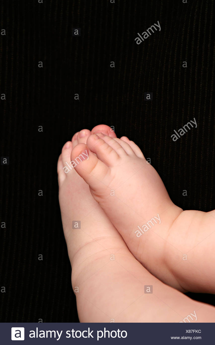 Baby feet close-up. - Stock Image