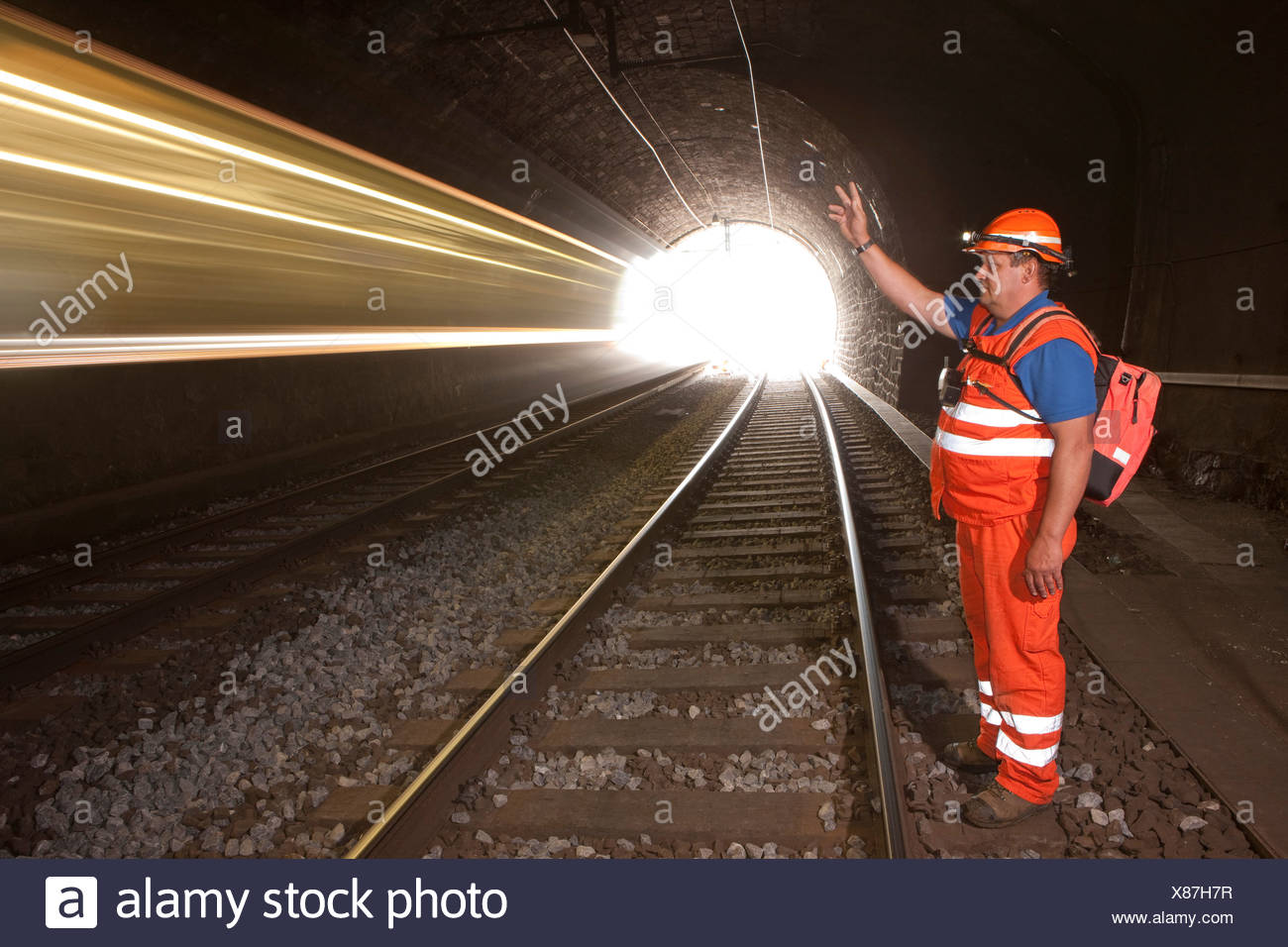 linesman, tunnel, road, railway, train, railroad, Lötschberg, BLS, Switzerland, Europe, security, safety, Bernese Oberland, ligh - Stock Image