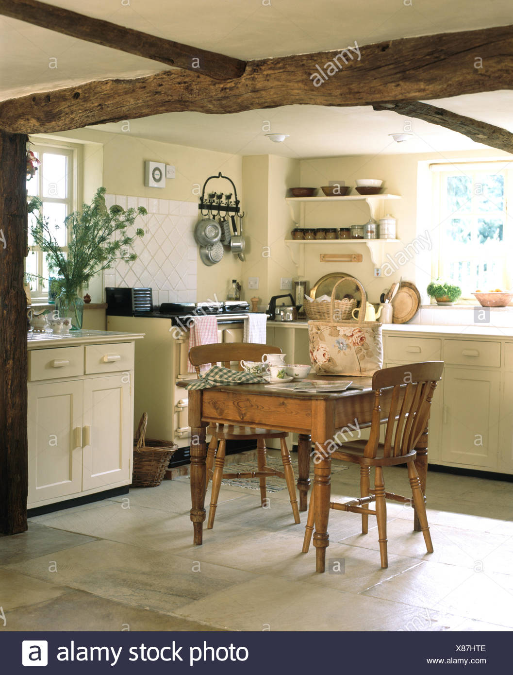 Vintage pine dining table and chairs in a cream cottage ...