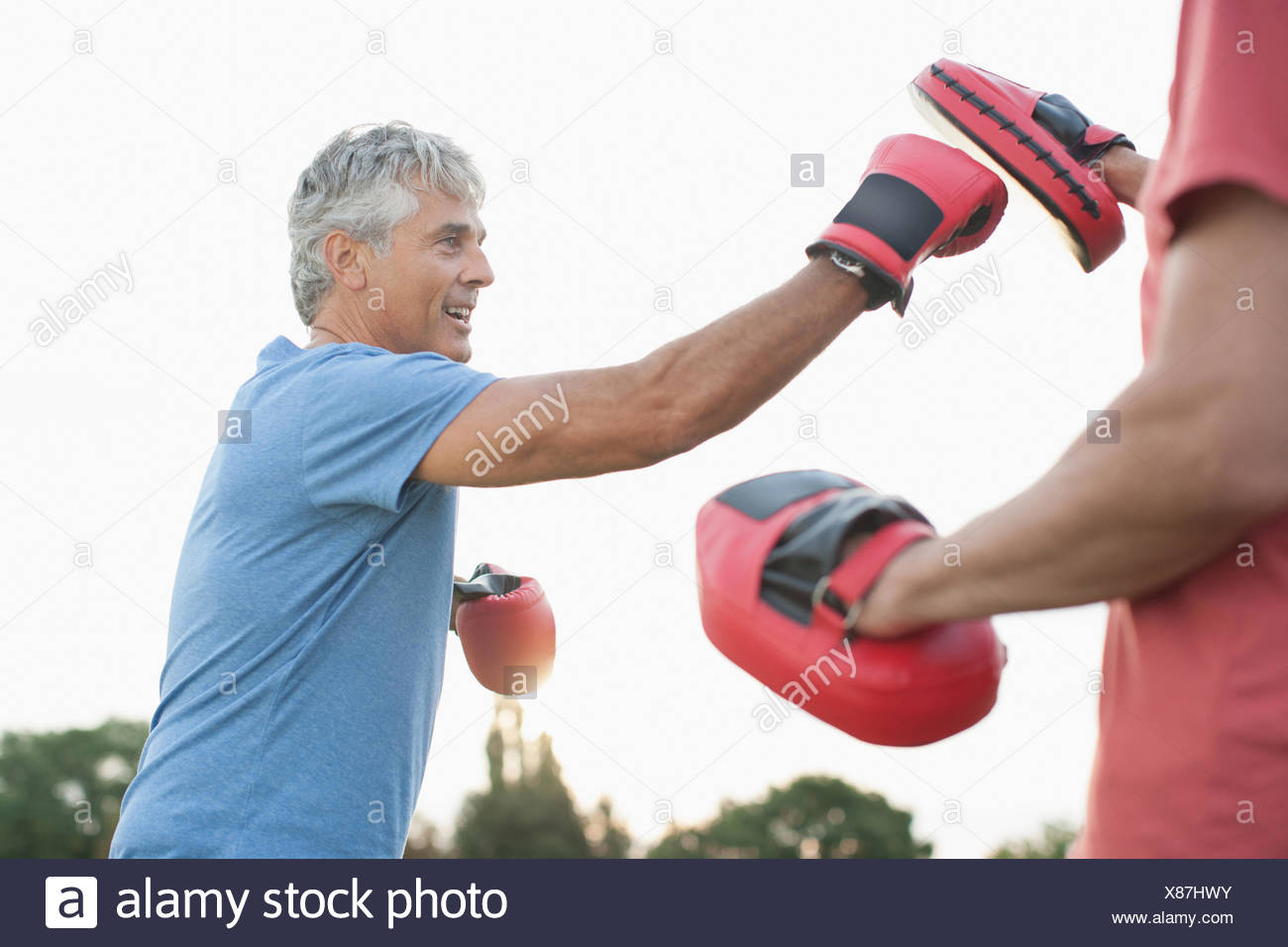 Boxer training with sparring partner - Stock Image