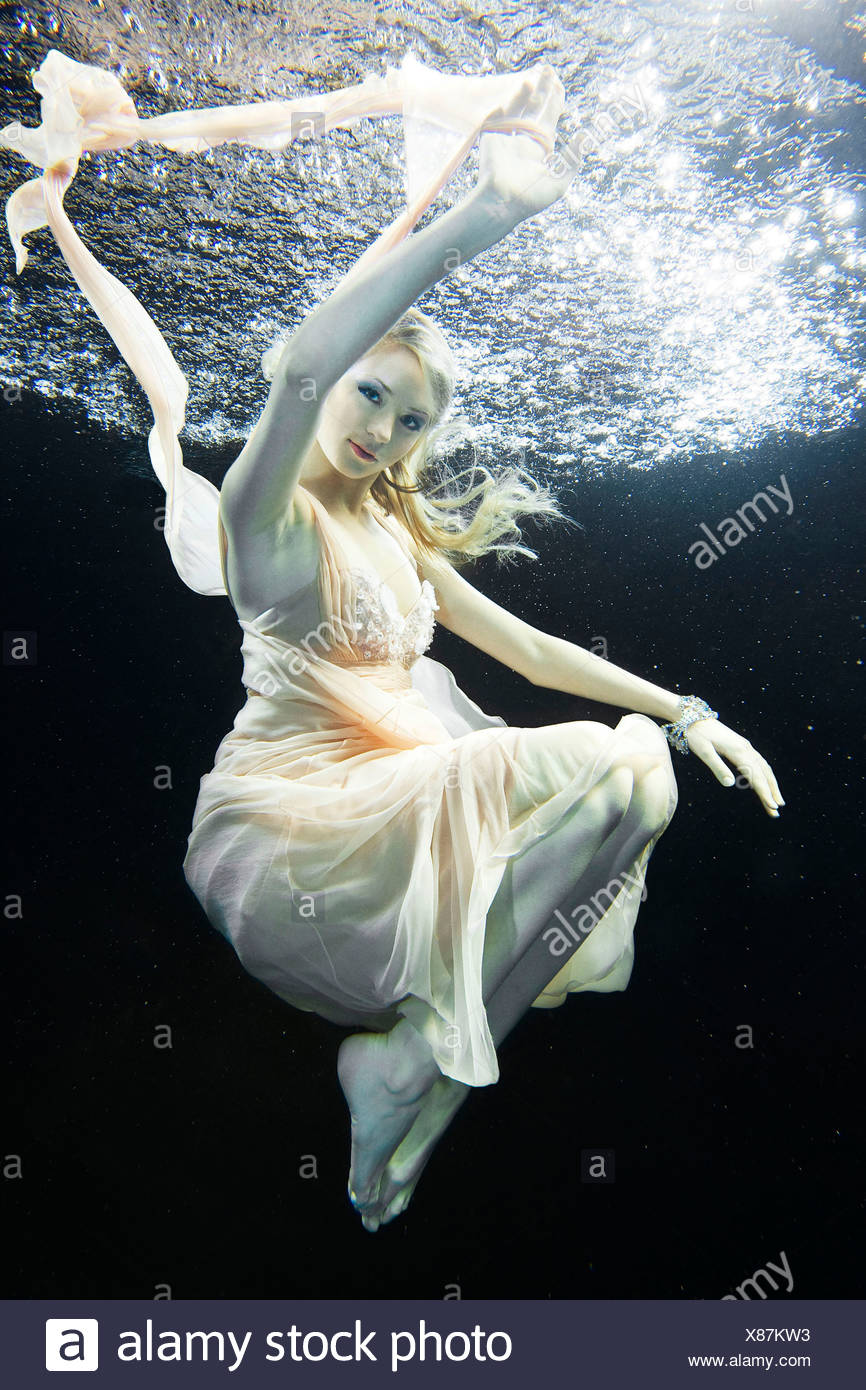 Young woman underwater - Stock Image
