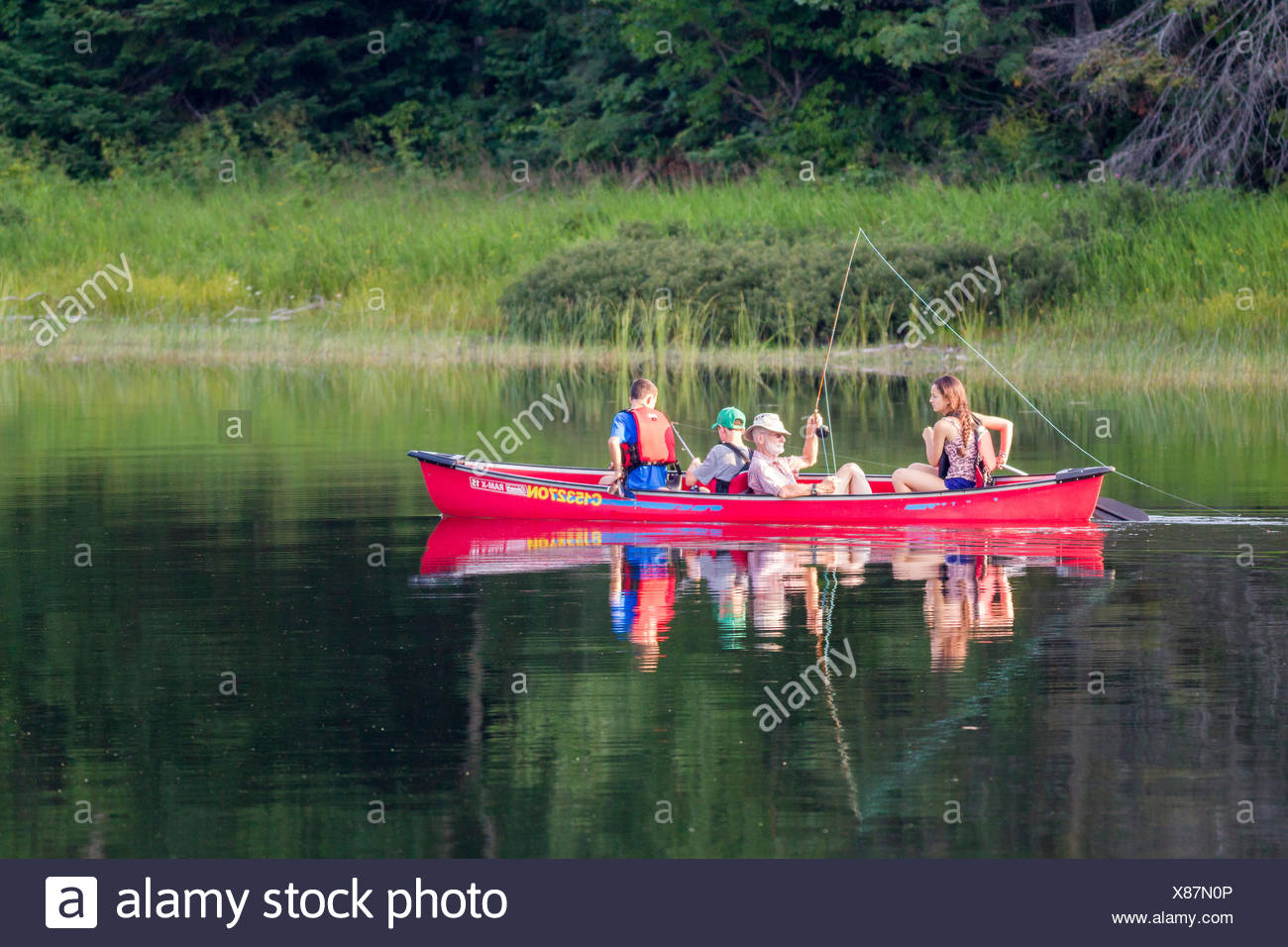 Family fishing on Crescent Lake in Lake Superior Provincial Park, Ontario, Canada Stock Photo