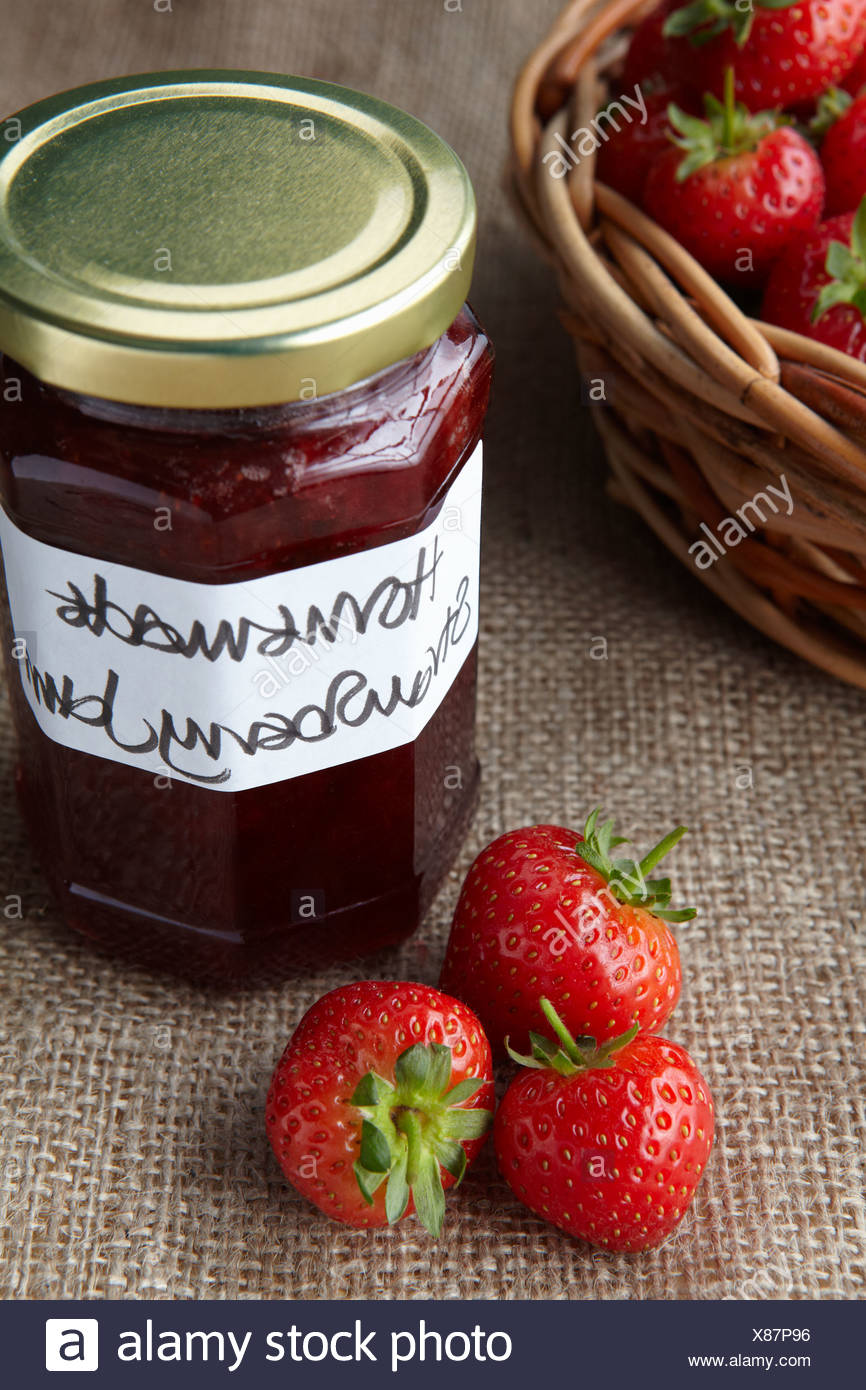 A still life of strawberry jam - Stock Image